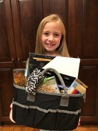 Student with art basket prize