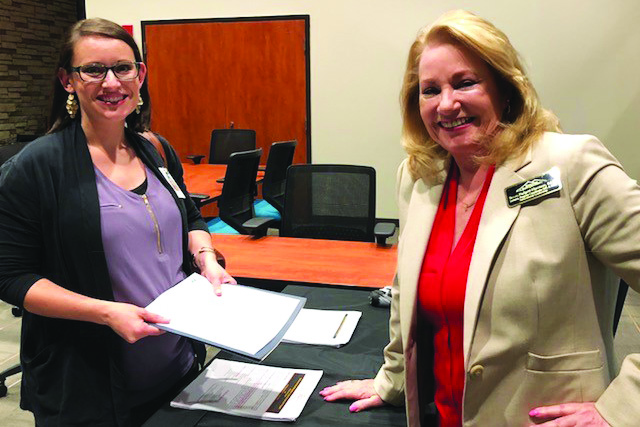 Newly appointed R.M. Moore ES Assistant Principal Denna Vance, left, speaks with Dr. Susan Padgett-Harrison about Kennesaw State University's program.