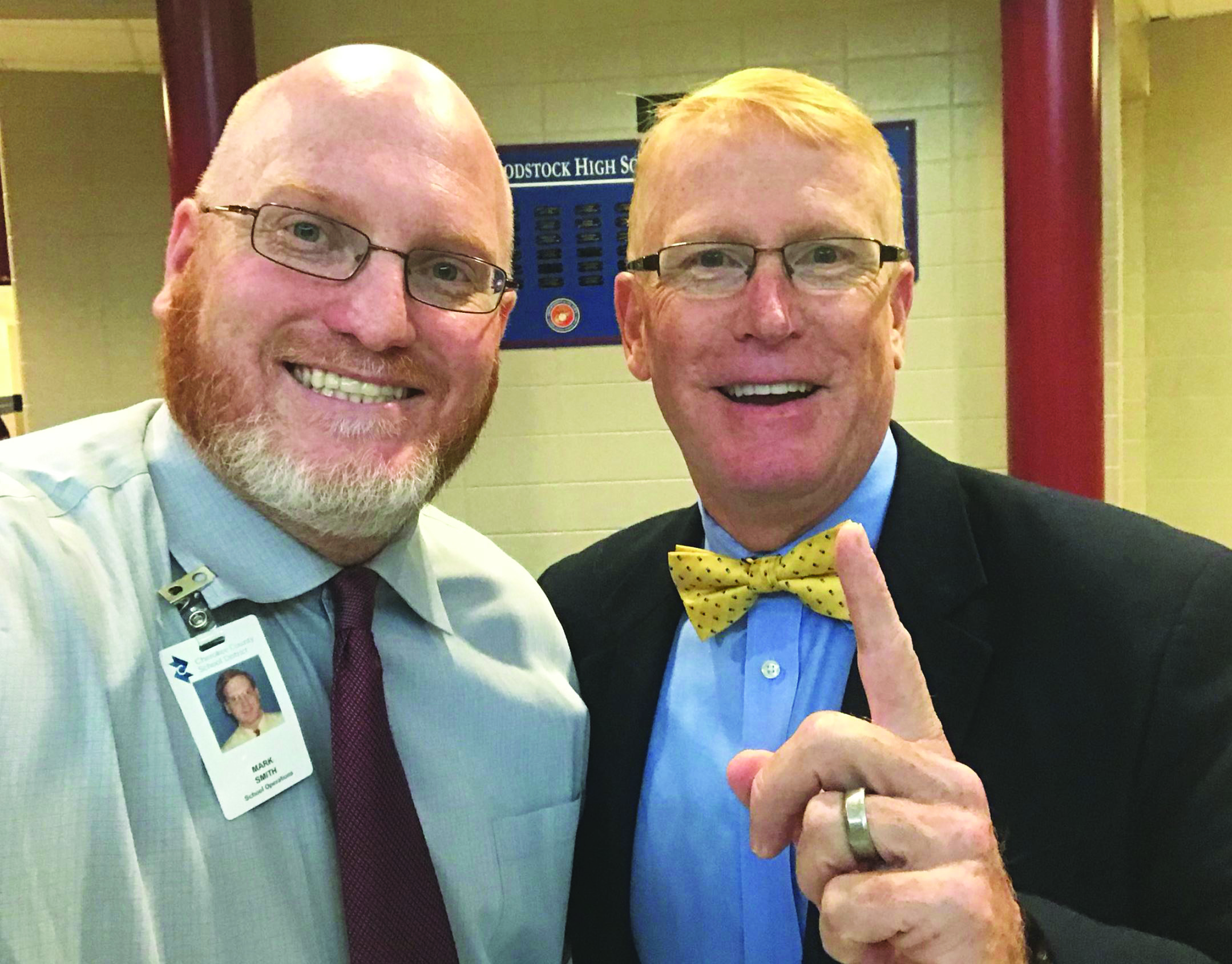CCSD Superintendent of Schools Dr. Brian V. Hightower, right, visits with Woodstock High School Principal Mark Smith on #CCSD1stDay.