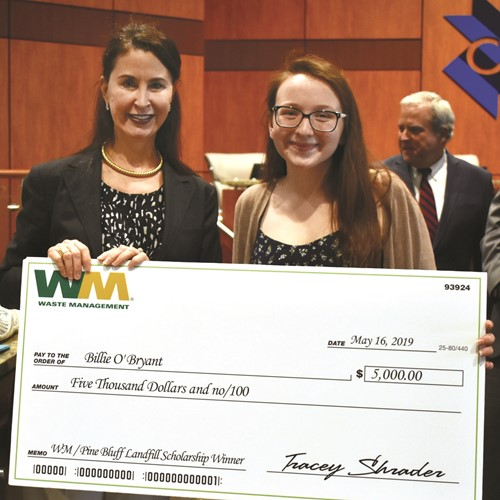 Marla Prince of Waste Management celebrates with scholarship winner River Ridge HS graduating senior Billie O'Bryant.
