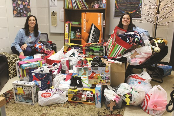 Bascomb Elementary School Counselors Kim Holstein and Dani Mabeus organize presents donated by the community to help Cherokee County students in need.