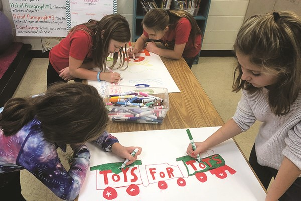 Clark Creek Elementary School STEM Academy Student Ambassadors, as part of their study of the Character Education trait Compassion, created displays to promote the school's sixth annual Toys for Tots drive.  From left to right, Chloe Peyton, Kate Holley, Chloe Pendley, and Bailey Boehringer.
