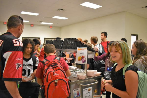 students getting breakfast items