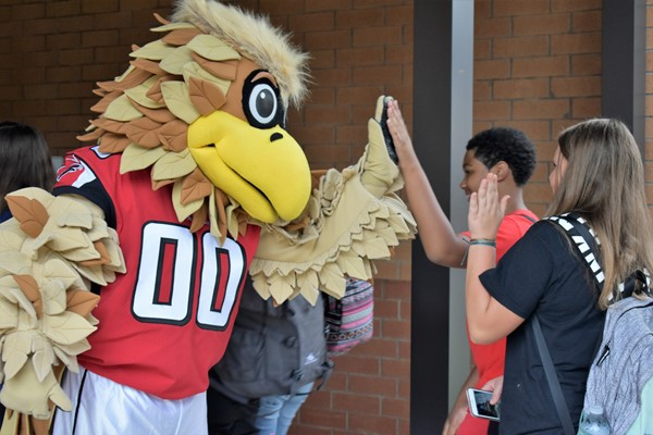 mascot greets students