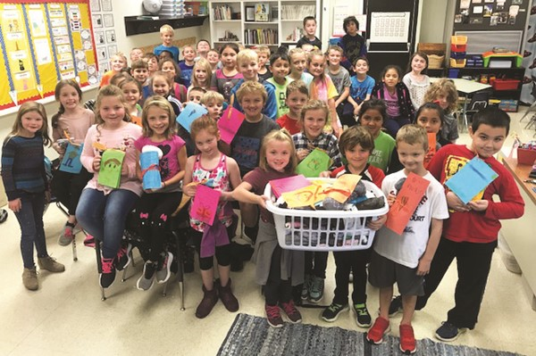 Free Home Elementary School students collected warm socks for residents in a local memory care facility and made cards to attach to the socks.  The school also held a toy drive for children living in foster care in the community.