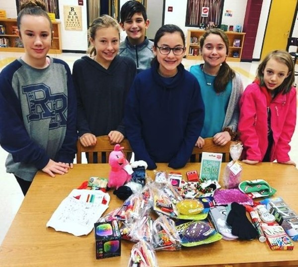 The Mill Creek Middle School PTSA Jr. Ambassador Club organized a drive to collect stocking stuffers for students in need.  From left to right: Quinn Colbeck, Kaitlyn Jensen, Graeme Navarro, Sidney Fialdini, Caroline Purvis, and Maggie Smith.