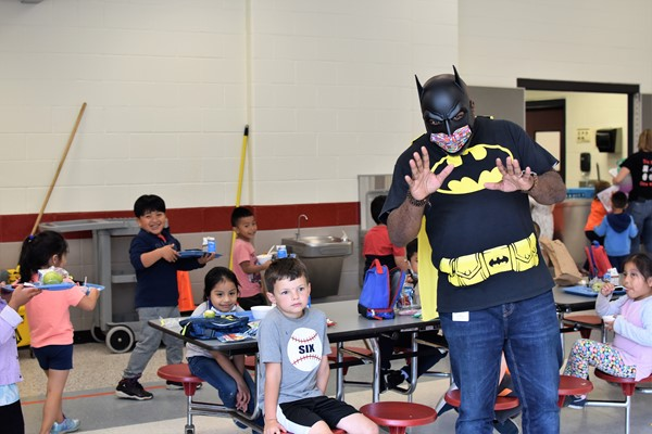 school cafeteria heroes serving lunch