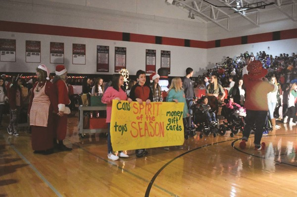 Teasley Middle School celebrated the end of a successful holiday charitable drive with its annual Spirit of the Season assembly on Friday featuring musical performances and skits from students and staff.  The collection, which will benefit local families in need, totaled 1,665 cans of food, 254 toys, and $2,000 in cash and gift card donations!