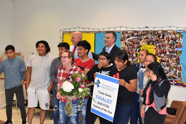 Superintendent makes surprise announcement of Teacher of the Year finalists w banner and flowers
