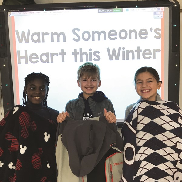 Woodstock Elementary School collected gently used and new warm coats and blankets for people of all ages.  The school's goal is to provide warm coats and blankets to children and adults in the community who need warmth during the cold winter months. Students, from left to right, Yayra Hodasi, Noah Koepke and Lola McGinnis sort donations.