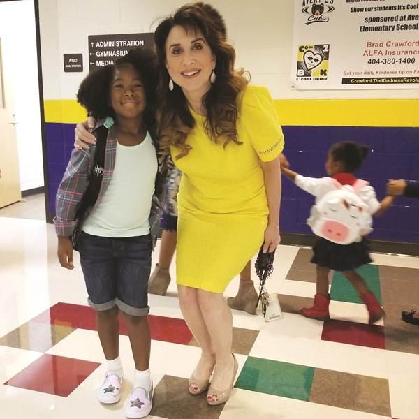 Avery ES Principal Dr. Lisa Turner and fourth-grader Dakota Calhoun.