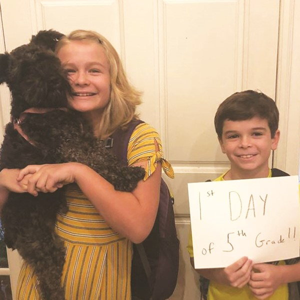 Bascomb ES fifth-graders Madeline and Robert Ragsdale and Dooley, who wishes he could go to school, too.