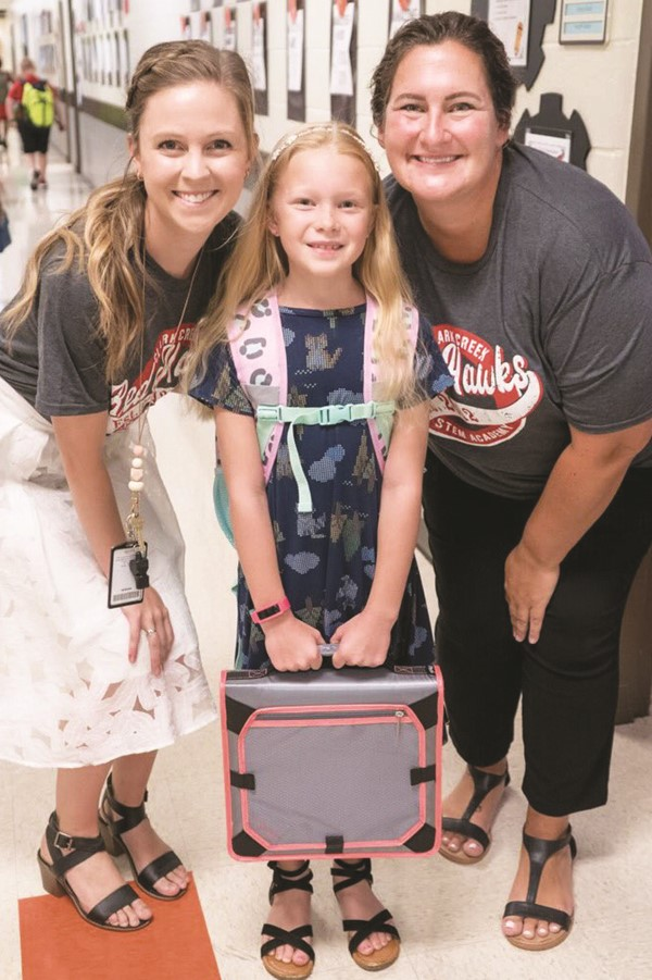 Clark Creek ES STEM Academy fourth-grader Julianne Sanders with teachers Lauren Cunningham and Krissy Cloud.