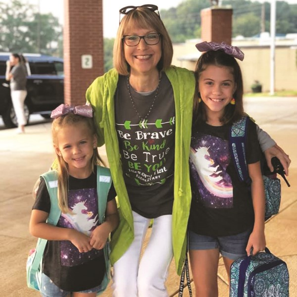 Hickory Flat ES first-grader Emme and fifth-grader Finley Ball and Principal Whitney Nolan.