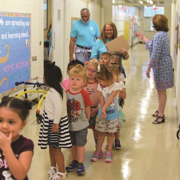 Ralph Bunche Center preschoolers in teacher Kim Childers' class walk down the hall together.