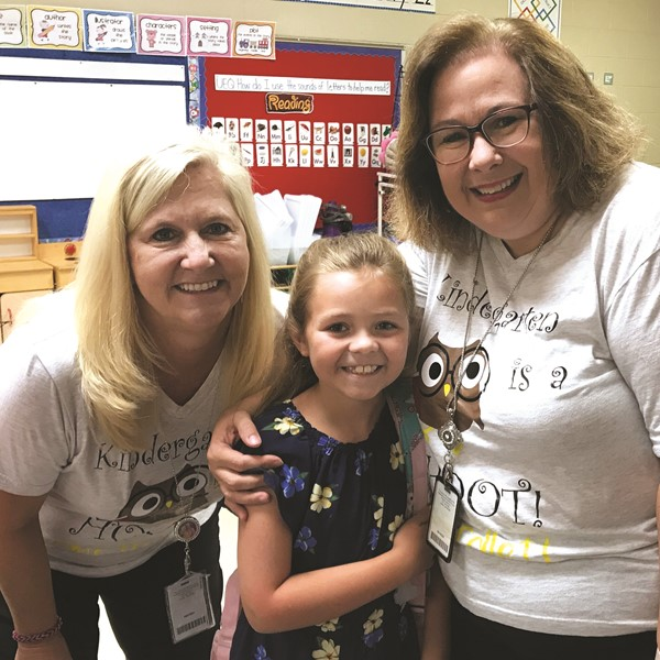 From left to right: R.M. Moore ES STEM Academy paraprofessional Kim Howell, second-grader Reese Ghorley and teacher Stephanie Collett.
