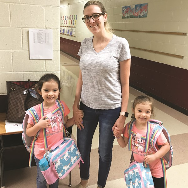 R.M. Moore ES STEM Academy kindergartner Sofia and prekindergartner Olivia Verdaguer arrive at school with mom, Veronica.