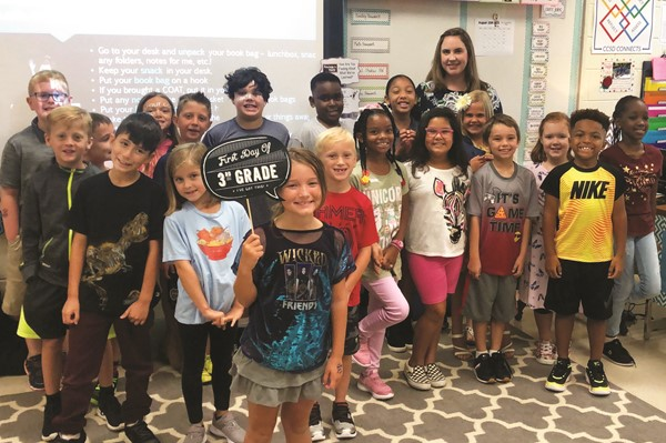 Woodstock ES third-grade teacher Lauren Caccavone and her class.