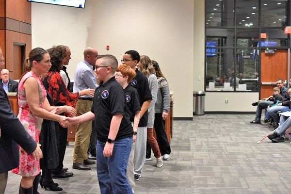 students and staff congratulated by school board