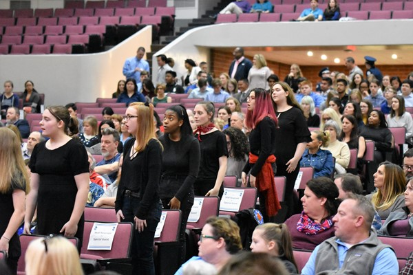 choral members sing at ceremony