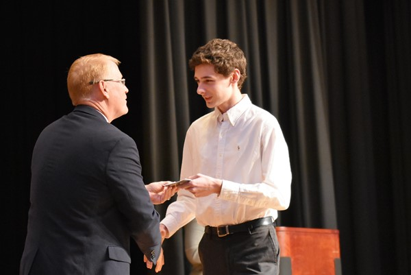 superintendent congratulates student on stage