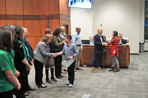 students being recognized by school board