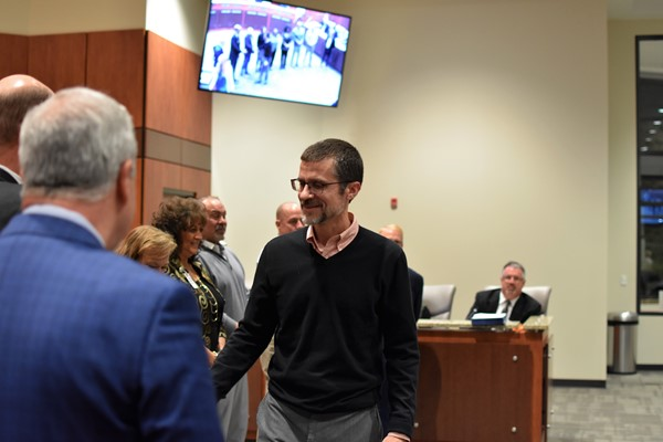 coach being recognized by school board