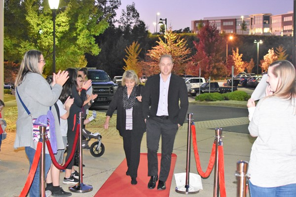 teachers walk red carpet