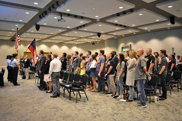audience stands for pledge of allegiance