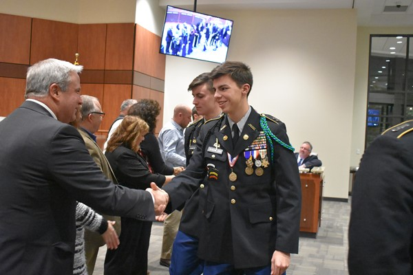cadets shaking hands with school board members