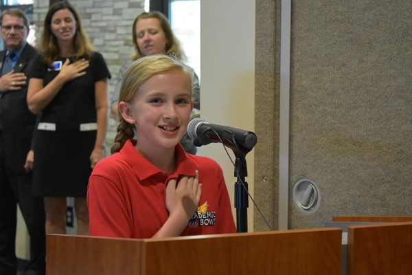 girl at podium saying pledge