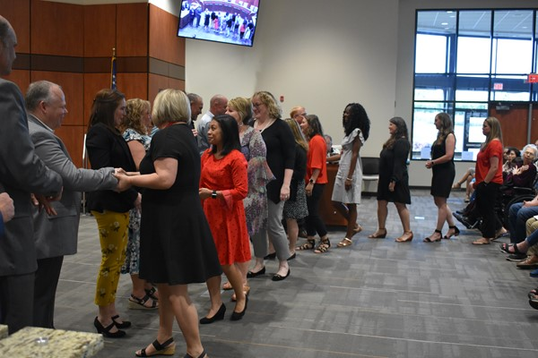 staff being congratulated by school board