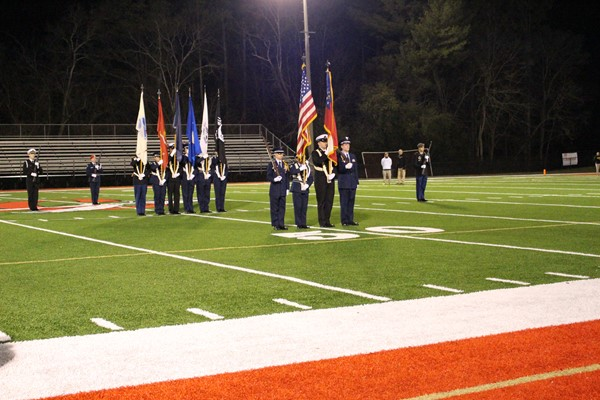 cadets walk flags across field