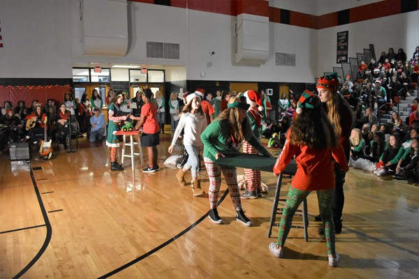 students dressed as elves perform a play