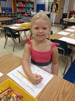 Picture of Kindergarten student coloring.