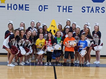 Photo of Flight of the Mission students with WHS cheerleaders