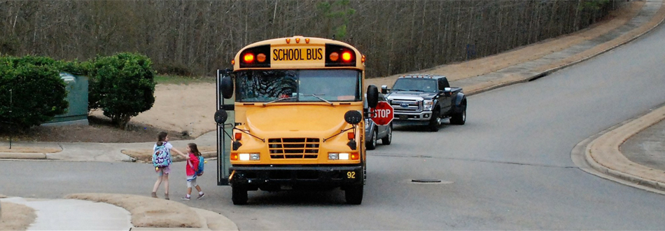 Students getting on a bus