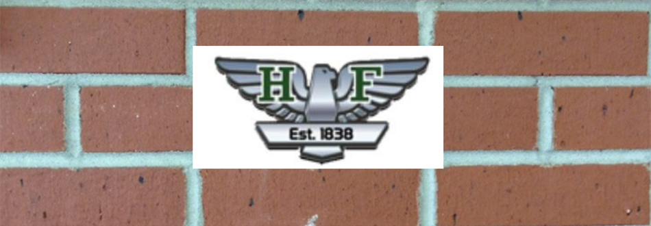 photo of brick wall with the HFES logo