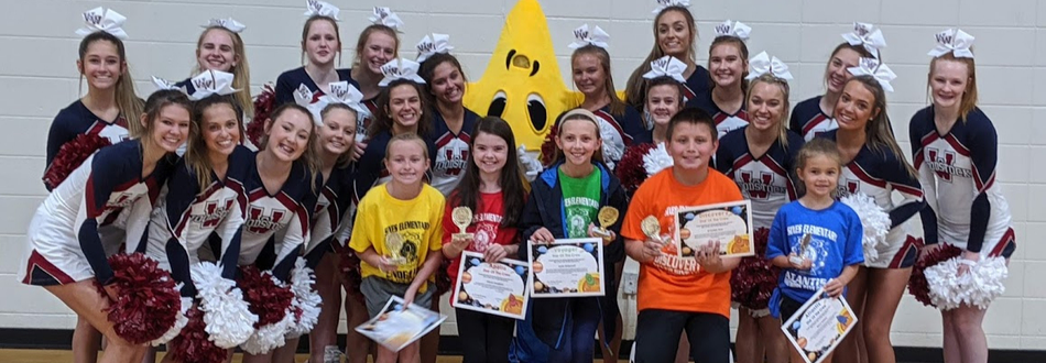 Photo of students at Sixes Elementary selected as the stars of the mission with WHS cheerleaders