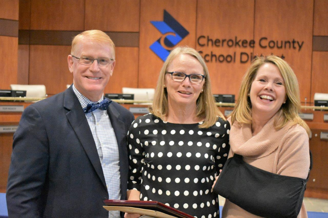 Superintendent of Schools Dr. Brian V. Hightower congratulates Carmel Elementary School kindergarten paraprofessional Sharon Borg, center, as CCSD Support Staff Employee of the Year from all elementary schools. Joining her in the celebration is Principal Paula Crumbley.