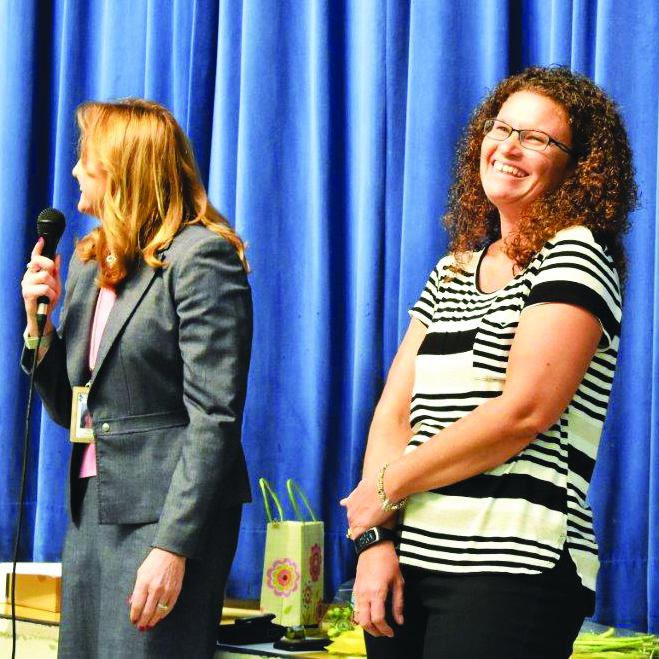 Indian Knoll ES Counselor Colleen DeLosh reacts with surprise at the announcement by Principal Kim Cerasoli that she has been named the CCSD 2019 Counselor of the Year.  The award presentation was made at a faculty meeting Tuesday afternoon.
