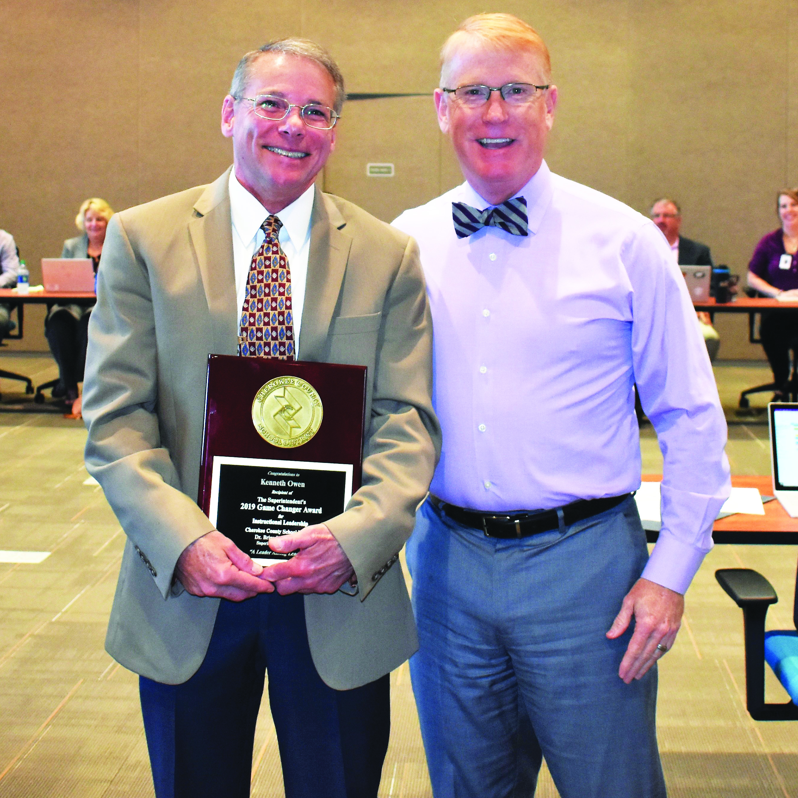 CCSD Chief Financial Officer Kenneth Owen, right, is congratulated by Superintendent of Schools Dr. Brian V. Hightower as the recipient of his 2019 Game Changer Award for Instructional Leadership.