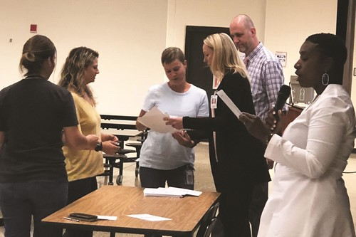 CCSD Supervisor of Special Education LaToya Gray, right, and program co-trainers, Teasley MS teachers Dr. Jennifer Reynolds and Greg Koch, present certificates to Sandra West, Winn Ward and Melissa Riddle of Bascomb ES.