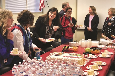 CCSD Media Specialist of the Year Anne Nechvatal, center, enjoys a reception with her Cherokee HS colleagues and guests after the surprise announcement of her award was made.