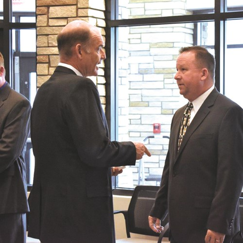 School Board member Mike Chapman, left, speaks with newly named CCSD Supervisor of Facility Support Services Scott Krug.