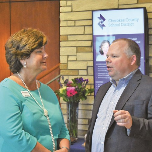 Janet Read of Children's Healthcare of Atlanta, which sponsored the reception, talks with School Board member Clark Menard.