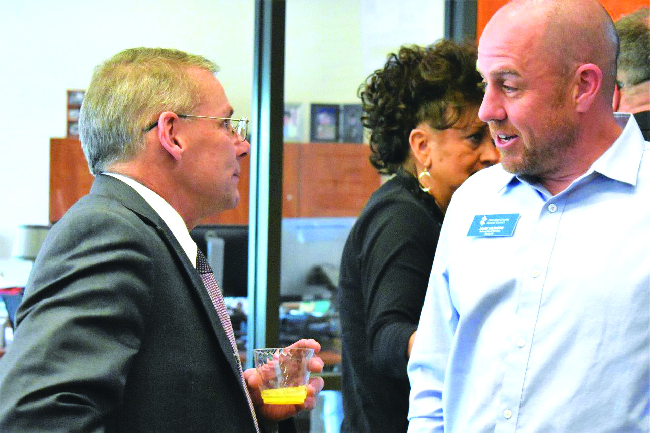 CCSD Chief Financial Officer Ken Owen greets School Board member John Harmon at the reception.