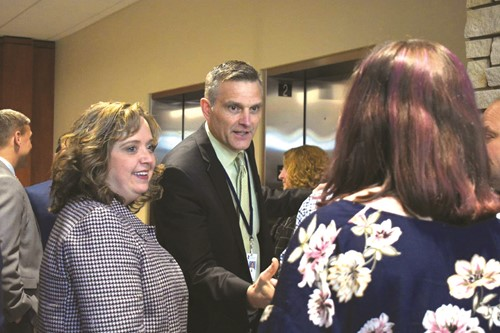 Newly named Clayton ES Principal Carrie O'Bryant, left, introduces Deputy Superintendent Trey Olson to her daughter, Emma, an eighth-grader at Teasley MS.