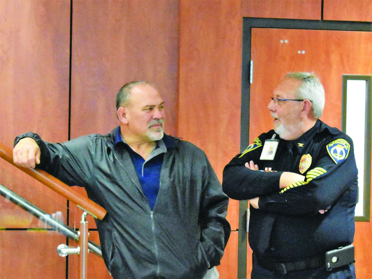 School Board member Rick Steiner, left, talks with CCSD School Police Chief Mark Kissel, who is retiring this year after 20 years of service that began with establishing the police department.