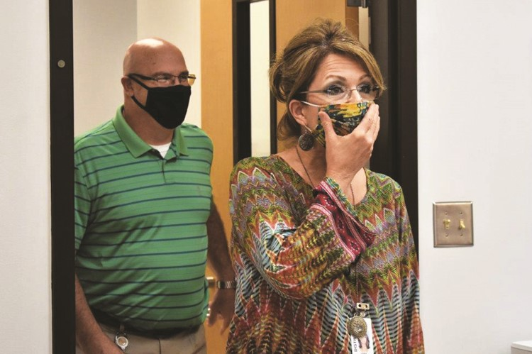 CCSD Transportation Department Secretary Debra Basone realizes she's in for a surprise as she walks into a staff meeting with Director Jim Georges and sees the Superintendent of Schools waiting for her with a CCSD 2020 Support Staff Employee of the Year Award plaque.